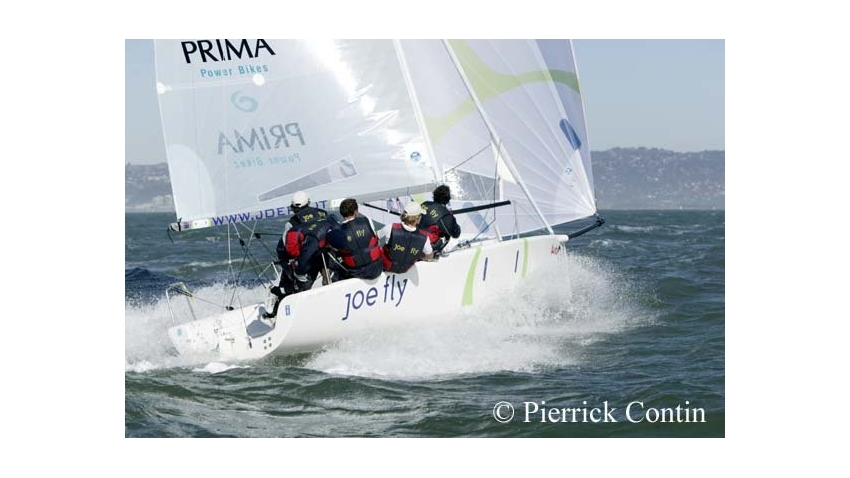 Luca Santella flies downwind on day 4 of the Melges 24 Worlds 2003